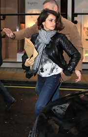 Penelope Cruz ran errands in London in a quilted black leather jacket and a subtle leopard print scarf.