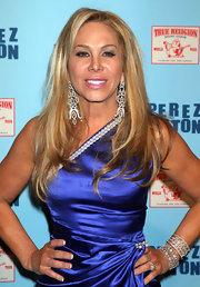 Adrienne Maloof loaded up on jewelry for Perez Hilton's birthday party, starting with a duo of diamond cuff bracelets.