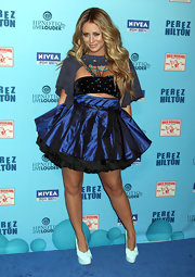 Aubrey O'Day donned white bow-adorned pumps with towering platforms to the Perez Hilton Blue Ball birthday celebration.