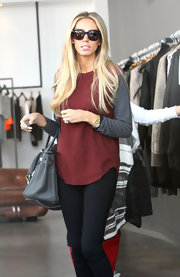 Petra Ecclestone kept things simple and un-fussy for a day of shopping in a two-tone baseball-style tee.