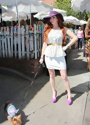 Phoebe Price chose a white mini skirt to pair with her white blouse for a crisp and clean daytime look.