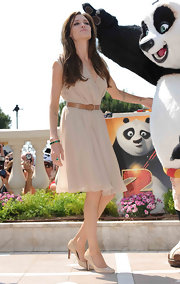 Angelina Jolie paired beige pumps with her pale, silky day dress at a photocall for 'Kung Fu Panda 2'. Her ladylike look was ultra pretty and polished.