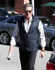 Pierce Brosnan stepped out in Beverly Hill wearing a classic button up paired with a zip-up vest for an added sporty feel.