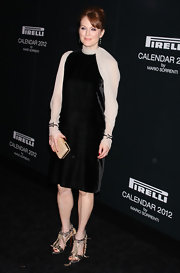 Julianne Moore wore a black velvet dress with sheer ivory sleeves for the Pirelli Gala in NY.