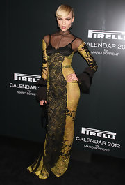 Natasha Poly wore a stand-out look at the Pirelli Gala Dinner in a yellow and black lacy number.