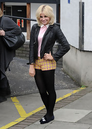 Pixie Lott tamed a pair of flirty tweed mini shorts with black opaque tights.