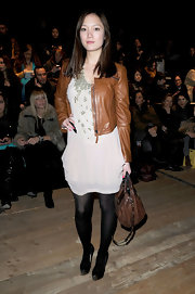 Pom Klementieff accented her look with black platform pumps accented with metallic silver toes.