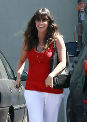 Alanis was spotted heading to the gym while carrying a cool leather tote bag.