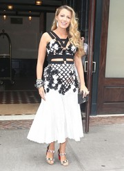Blake Lively donned a sweet-meets-bondage flower-appliqued cutout dress by Emanuel Ungaro for a day out in New York City.