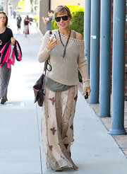 Elsa Pataky looked relaxed and feminine in a butterfly and paisley print chiffon maxi skirt.