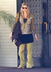 Fergie topped off her boho look with yellow printed pants.
