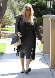 Fergie sported an all-black maternity look when she wore this flowing black cardigan over a long maternity top.