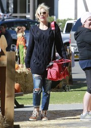 Gwen Stefani looked laid-back in a navy cable-knit sweater and ripped jeans during a day out with her family.