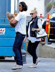 Gwen Stefani finished off her casual look in edgy style with a black leather vest during a visit to the vet.