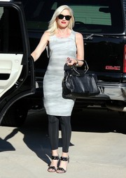 Gwen Stefani attended a baby shower wearing a simple yet stylish gray day dress over black leggings.