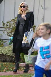 Gwen Stefani looked every inch the superstar in a satin-lapel black coat as she took her boys to a play date.