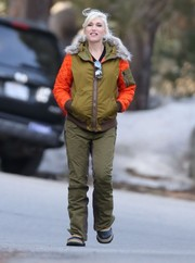 Gwen Stefani battled the cold in vibrant style with this olive-green down jacket with quilted orange sleeves and a fur collar.