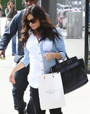 Jenna Dewan-Tatum covered her baby bump with a two-toned blue and white button down while out shopping in LA.