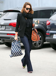 Jessica wears a pair of dark denim flares with her platforms for while out and about in Santa Monica.