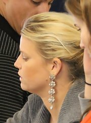 Jessica Simpson wore a sparkly pair of chandelier earrings with her otherwise very casual ensemble while going through security at LAX.