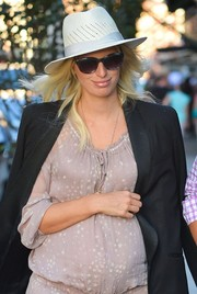 Karolina Kurkova accessorized with a white fedora for extra sun protection.