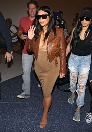 Kim Kardashian showed her edgy pregnancy style with this brown leather jacket by Faith Connexion while catching a flight at LAX.