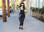 Kim Kardashian left the gym in a pair of black sneakers.