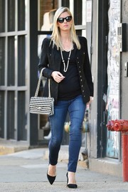 Nicky Hilton teamed a Chanel chain-strap bag with a tweed jacket (also by Chanel) and skinny jeans for a day out in New York City.