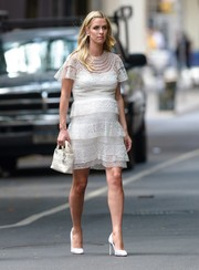 Nicky Hilton turned heads on the streets of New York City in this tiered lace maternity dress.