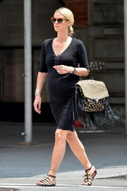 Nicky Hilton took a stroll in Soho wearing a black lace-up maternity dress by Monrow.