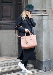 Rosie Huntington-Whiteley kept a low profile in a black coat by The Perfext teamed with a fedora while shopping in New York City.