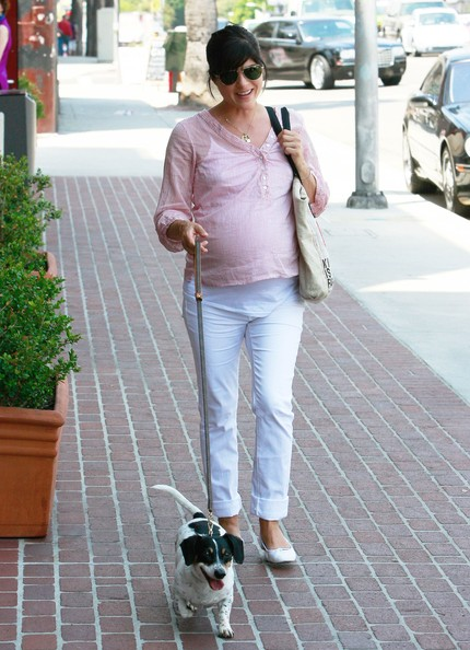 Selma Blair stayed stylish while walking her dog in cuffed white jeans and matching ballet flats.