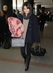 Rachel Bilson trekked through the airport in slouchy black leather boots.
