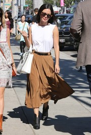 Rachel Bilson styled her top with a billowy brown midi skirt.