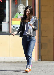 Rachel Bilson elevated her boyfriend jeans with a ladylike gray jacket.