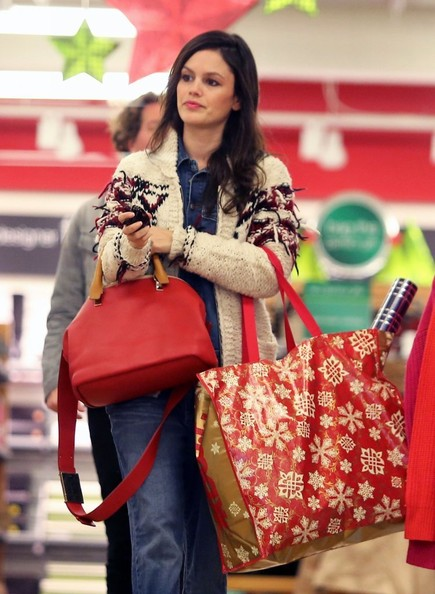 Rachel Bilson looked very Christmassy with her red Chloe cross-body tote and patterned cardigan.