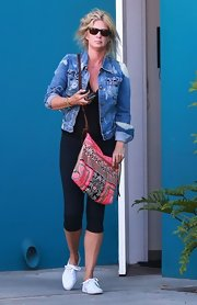Rachel Hunter wore a distressed denim jacket over an all black workout look while leaving a Pilates class.