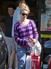 Rachel McAdams added some color to her casual look with this purple striped sweater.