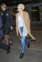 Rachel McAdams rocked her airport outfit in a beige wool coat while making her way through LAX.