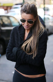 Here, Rachel Uchitel wears her hair in a simple pulled back ponytail.