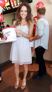 Rebecca Breeds looked endearing in a pale blue sundress while visiting McDonalds.