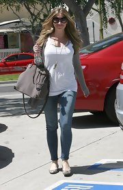 New mommy Rebecca Gayheart was spotted out and about in West Hollywood while toting around a tan tote bag.