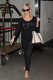 Reese played up the retro look with black and white polka dotted pants.