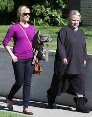 Reese Witherspoon sported a vibrant purple crewneck sweater while out with her family.
