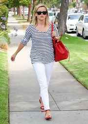 Reese sported a totally summer look when she wore this blue striped boatneck top.