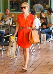Reese Witherspoon looked ready for summertime in this belted tangerine shirt dress.