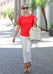 Reese opted for a totally sophisticated look with this red blouse paired with white jeans.