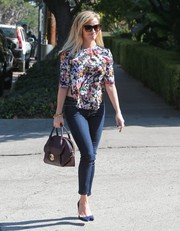 Reese Witherspoon looked very summery in a floral blouse with cutaway sides while out and about in Brentwood.