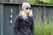 Actress Reese Witherspoon who became engaged over the holidays to her boyfriend Jim Toth seen leaving a friends house in Santa Monica, CA.