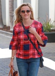 Reese Witherspoon headed out under the Beverly Hills sun wearing a pair of 70s-chic pink shades.